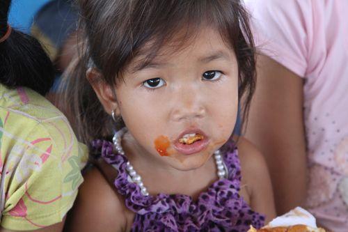 Cambodian girl eating